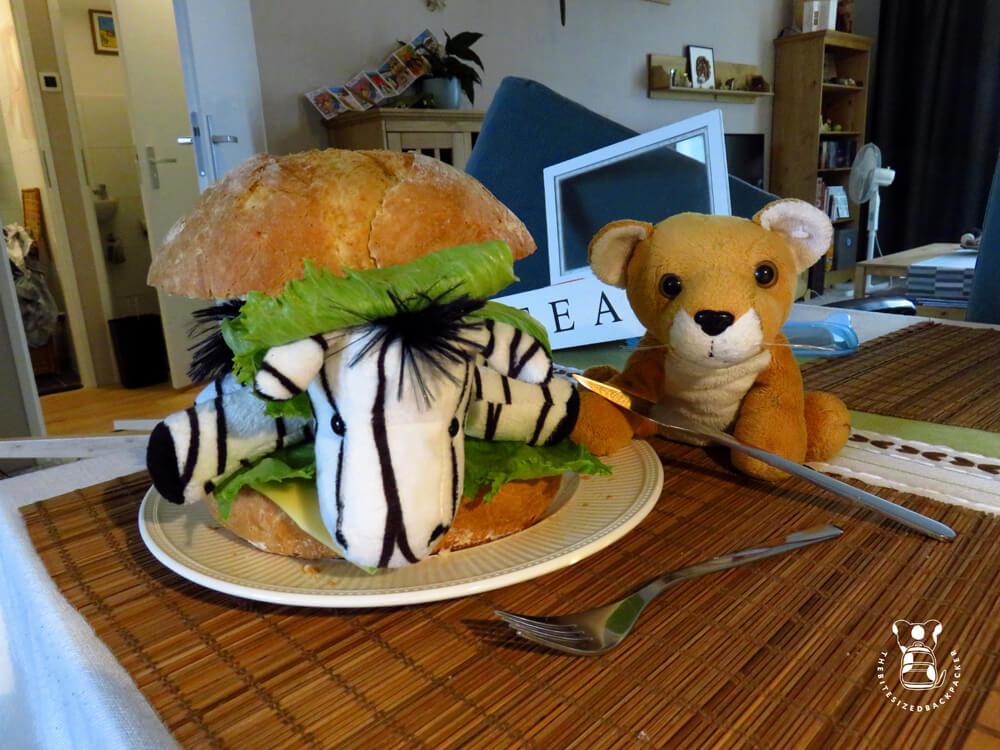 Fluffy prepares a zebra burger