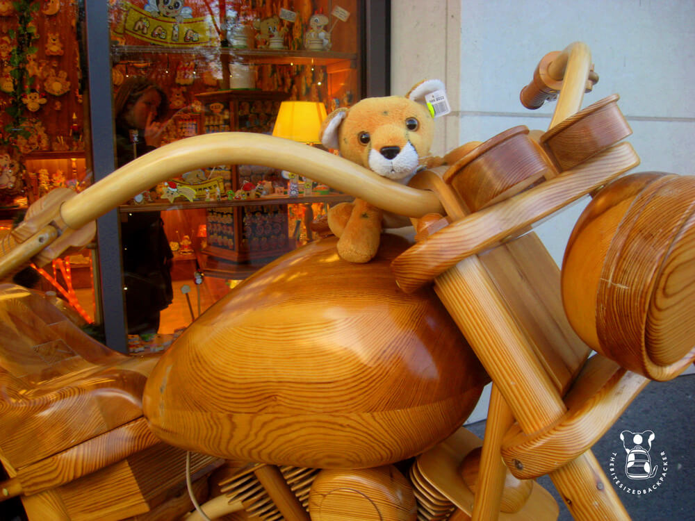 Fluffy rides a wooden motorcycle in Berlin