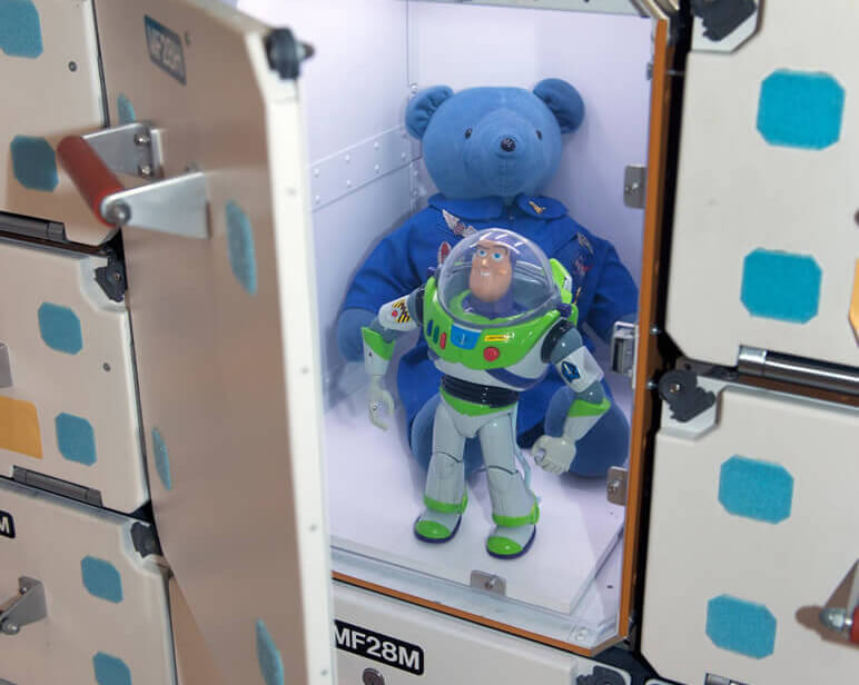 Toy astronauts Magellan T. Bear and Buzz Lightyear at the ISS