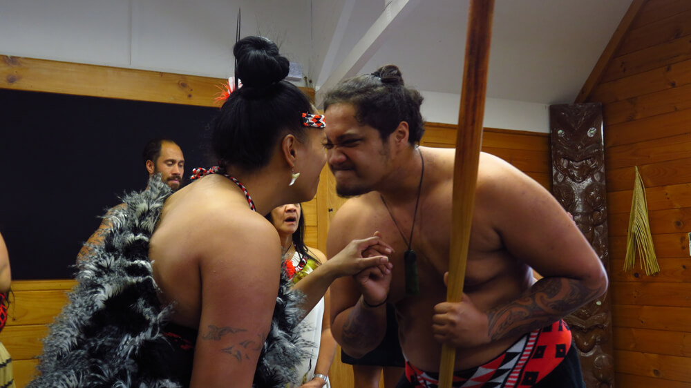 Performing the traditional Māori greeting, the hongi